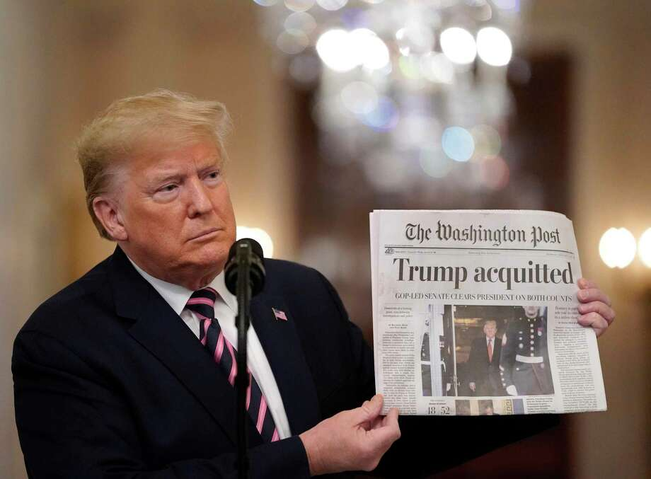 U.S. President Donald Trump holds a copy of The Washington Post Feb. 6 as he speaks at the White House a day after the U.S. Senate acquitted him on two articles of impeachmen in Washington, D.C. Photo: Drew Angerer / Getty Images / 2020 Getty Images