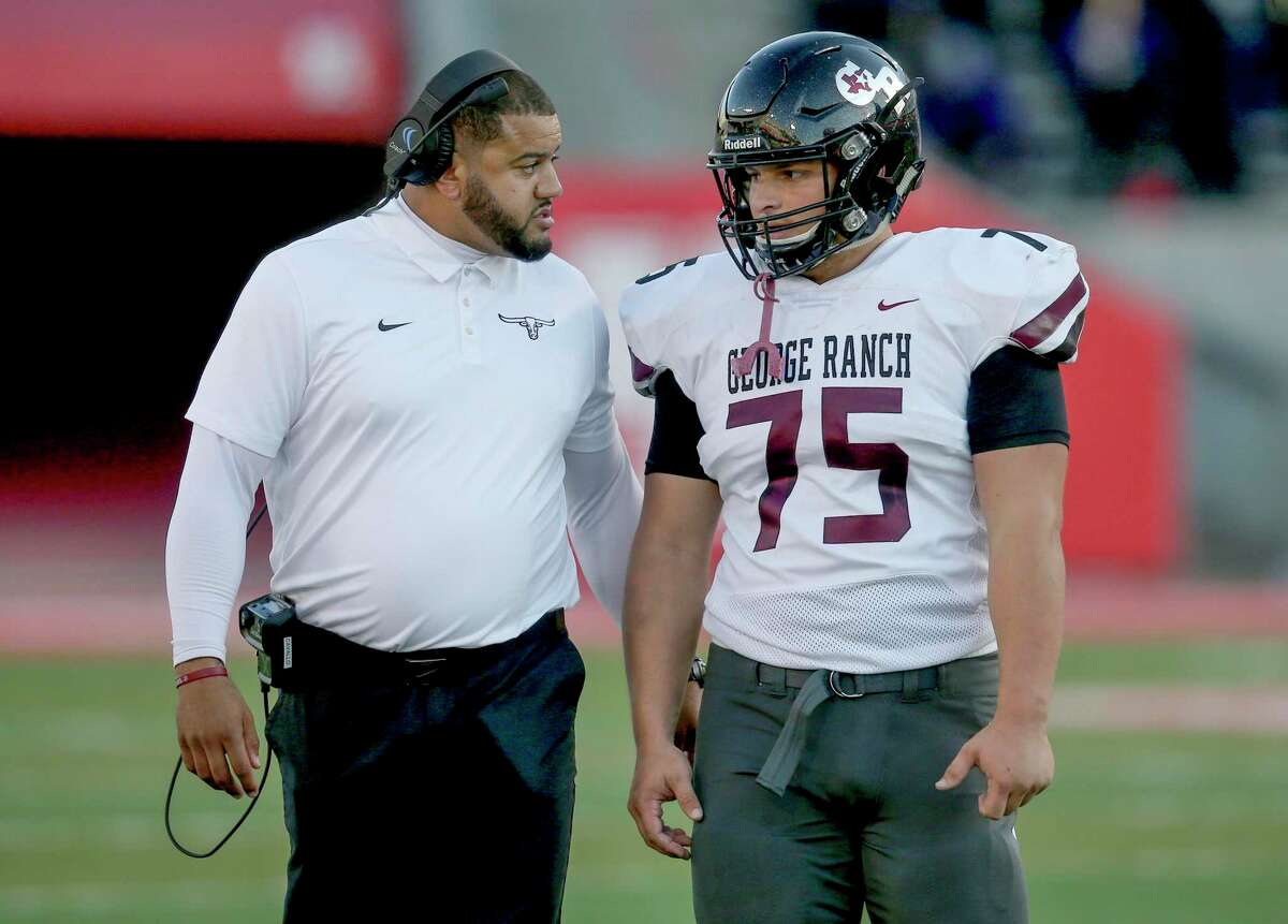 George Ranch Longhorns head coach Nicholas Cavallo talks with lineman Kevin Ireson (75) during a Humble Wildcats timeout in the first half in a high school playoff football game on November 23, 2019 at TDECU Stadium in Houston, TX.