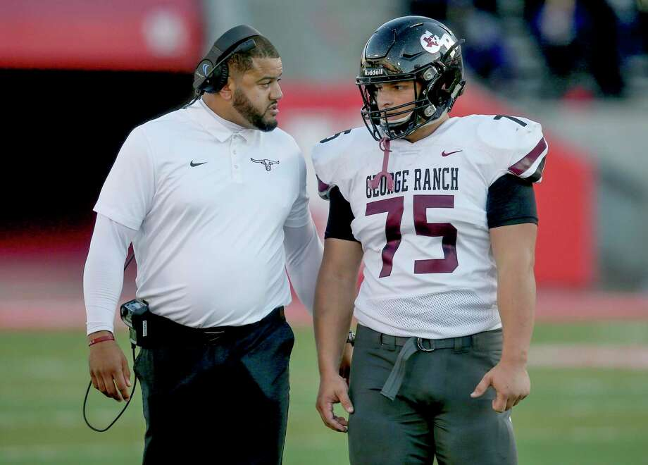 George Ranch Longhorns head coach Nicholas Cavallo talks with lineman Kevin Ireson (75) during a Humble Wildcats timeout in the first half in a high school playoff football game on November 23, 2019 at TDECU Stadium in Houston, TX. Photo: Thomas B. Shea, Houston Chronicle / Contributor / © 2019 Thomas B. Shea / Houston Chronicle / Contributor