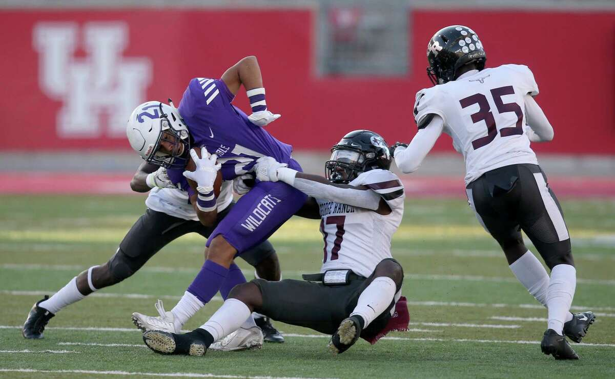 Humble Wildcats wide receiver Kevin Diaz (21) is tackled by George Ranch Longhorns linebacker Tim Fisher (17) in the first half in a high school playoff football game on November 23, 2019 at TDECU Stadium in Houston, TX.