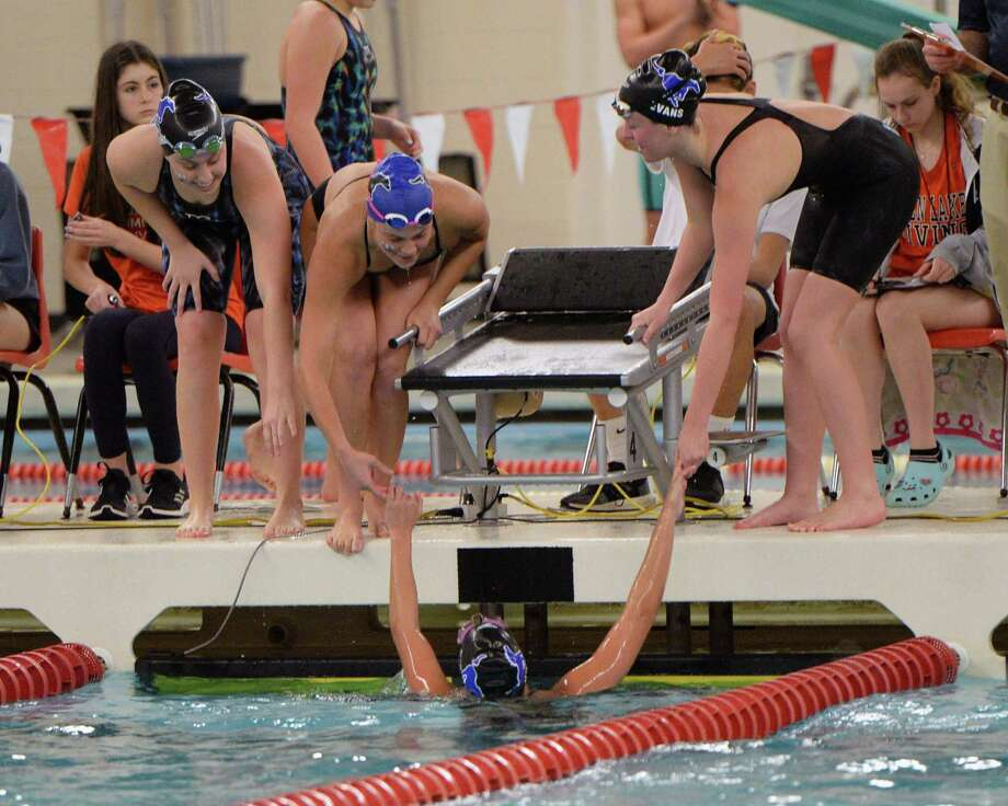 Kat Pashen of the Taylor Mustangs is welcomed by team mates Emma Clark, Emma Sticklen and Amy Evans after completing the last leg of the girls 200 yard medley relay during the District 19-6A Swimming and Diving Championships on January 18, 2020 at the Katy HS Natatorium, Katy, TX. Photo: Craig Moseley, Houston Chronicle / Staff Photographer / ©2020 Houston Chronicle