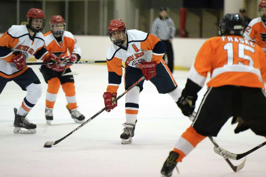 Cameron Heiser (9) of Seven Lakes eyes a shot during the second period of an Interscholastic Hockey League game between Pearland/Friendswood and Seven Lakes on Friday, February 7, 2020 at Memorial City Mall, Houston, TX. Photo: Craig Moseley, Houston Chronicle / Staff Photographer / ©2020 Houston Chronicle