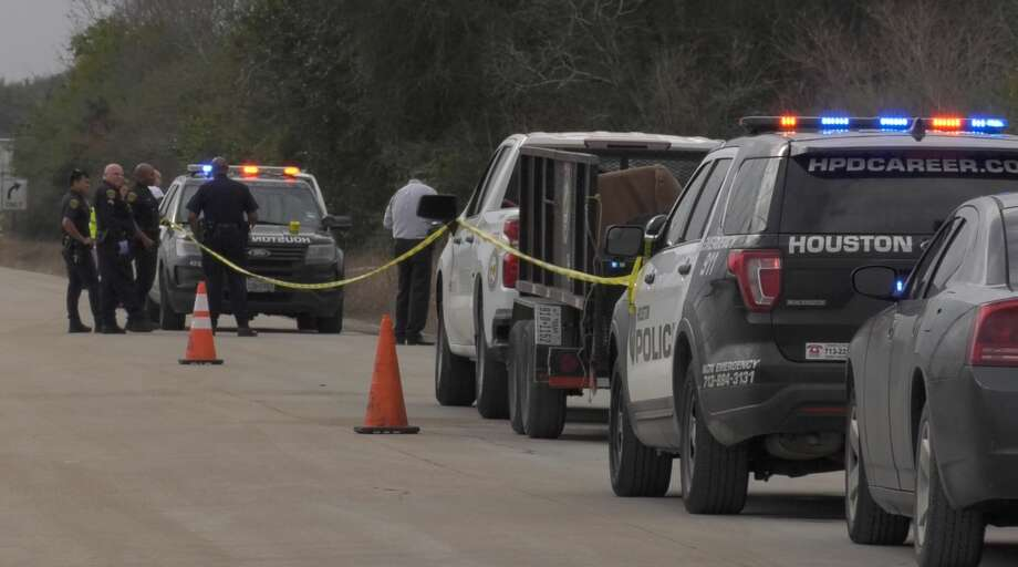 Houston police officers investigate the discovery of a body near a road called Parcel 3 near the intersection of Hiram Clark Road and Alt. U.S. 90. on Monday, Feb. 10, 2020. Photo: Jay R. Jordan / Houston Chronicle