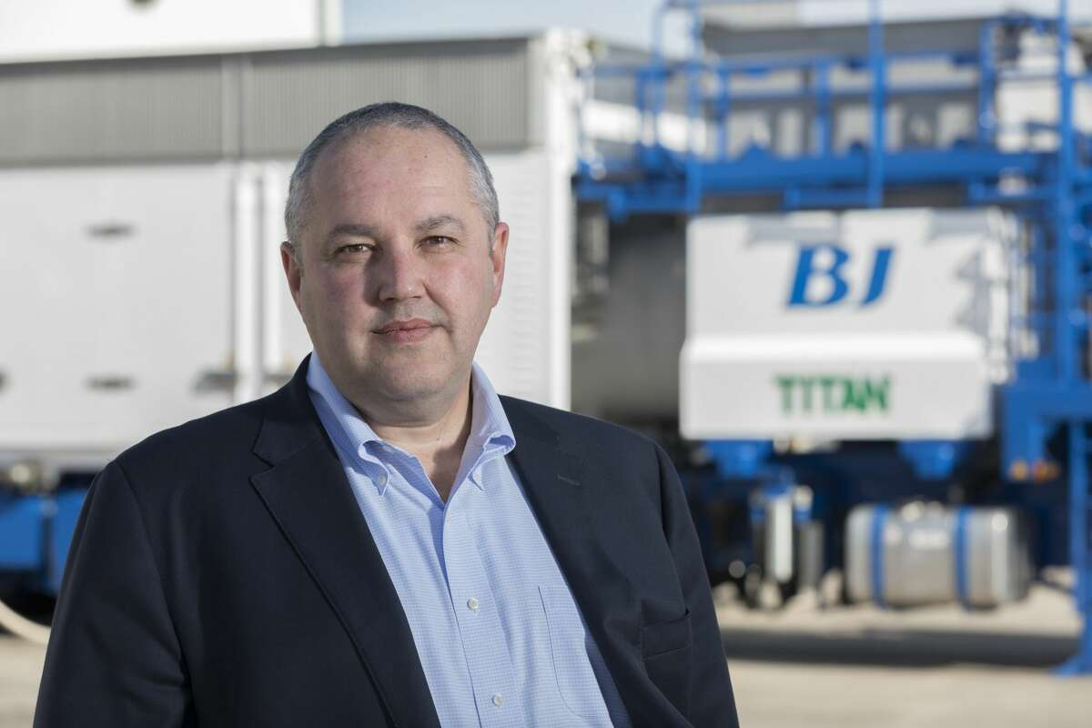 BJ Services CEO Warren Zemlak stands in front of the Titan, a new piece of equipment that uses a natural gas-fired turbine to power a hydraulic fracturing pump. Tested in the Haynesville Shale of East Texas, the Titan will now be deployed in the Eagle Ford Shale of South Texas and the Permian Basin of West Texas.