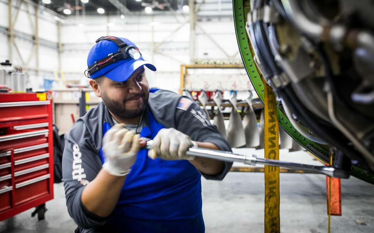 A Southwest Airlines Mechanic works on a Boeing 737 inside the carrier's hangar at William P. Hobby Airport.