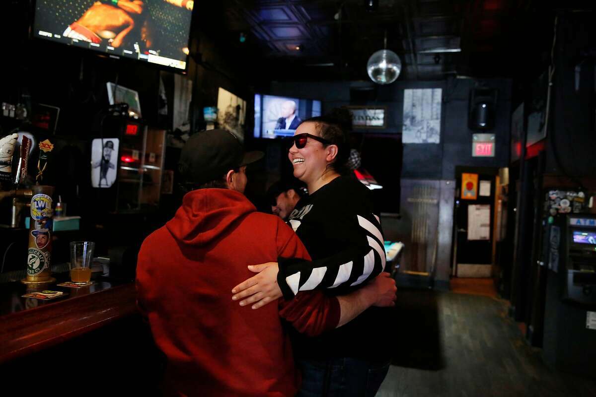Columbus Cafe customers Daniel Blume (l to r) of San Francisco and Jennifer Jones (Travis AFB) share a laugh at the Columbus Cafe on Thursday, February 6, 2020 in San Francisco, Calif.