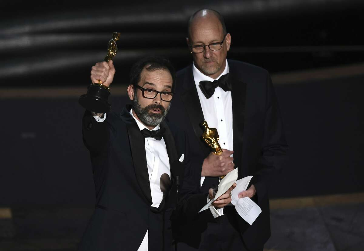 Andrew Buckland, left, and Michael McCusker accept the award for best film editing for