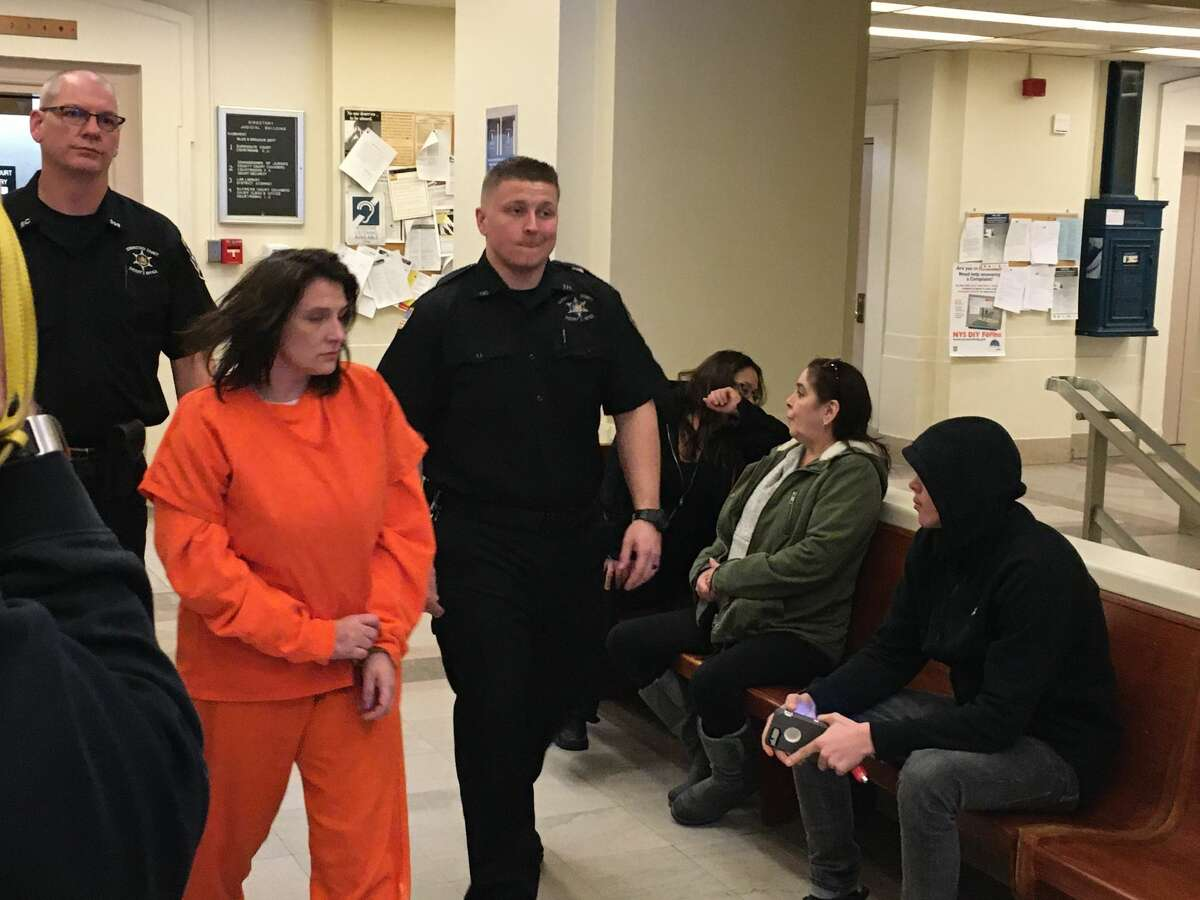 Casey Buckley, a 38-year-old Schenectady woman accused of robberies in Schenectady and Rotterdam, is led into court for a bail hearing Monday morning in Schenectady County court.