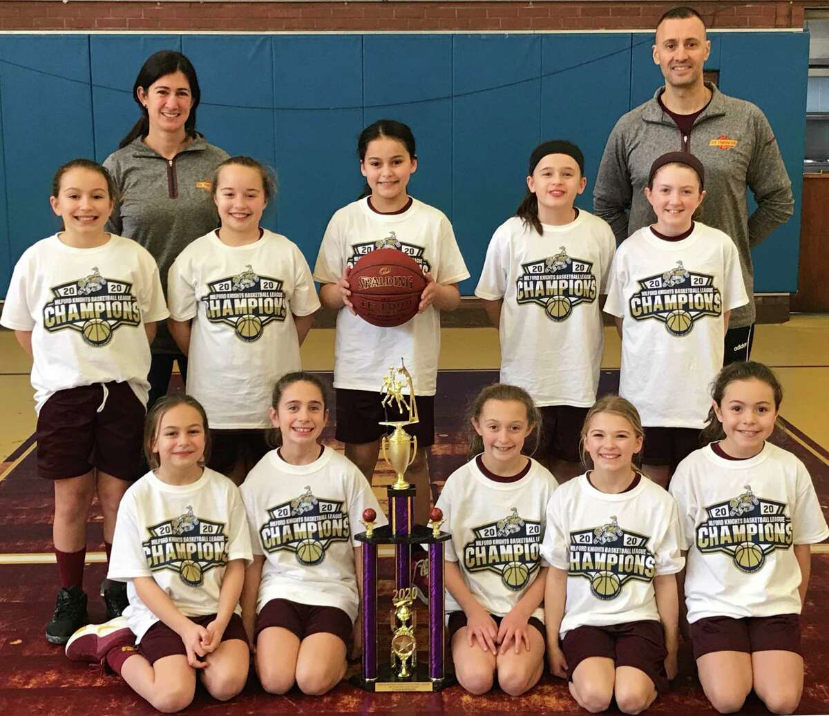 The St. Theresa's Parish 4th grade girls' basketball team won the Milford Knights League Gold Division Championship to complete an undefeated 11-0 season. Team members (front row) are: Lia Solustri, Samantha Russo, Ashlyn Delaney, Ava Buswell and Gianna Colon; (second row) Kelly Lungi, Harper Delaney, Francesca DiMarco, Gianna Holinko and Veronica Buckley; (third row) head coach Traci Sacco and assistant coach Frank DiMarco.
