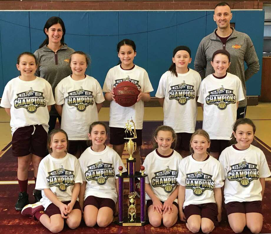 The St. Theresa's Parish 4th grade girls' basketball team won the Milford Knights League Gold Division Championship to complete an undefeated 11-0 season. Team members (front row) are: Lia Solustri, Samantha Russo, Ashlyn Delaney, Ava Buswell and Gianna Colon; (second row) Kelly Lungi, Harper Delaney, Francesca DiMarco, Gianna Holinko and Veronica Buckley; (third row) head coach Traci Sacco and assistant coach Frank DiMarco. Photo: Contributed Photo / St. Theresa School / Trumbull Times