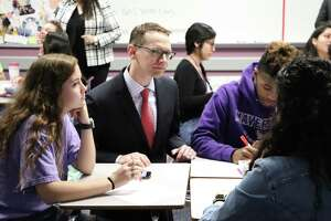 Mike Morath, Texas Education Agency (TEA) commissioner of education, visits with students at Morton Ranch High School on Tuesday.