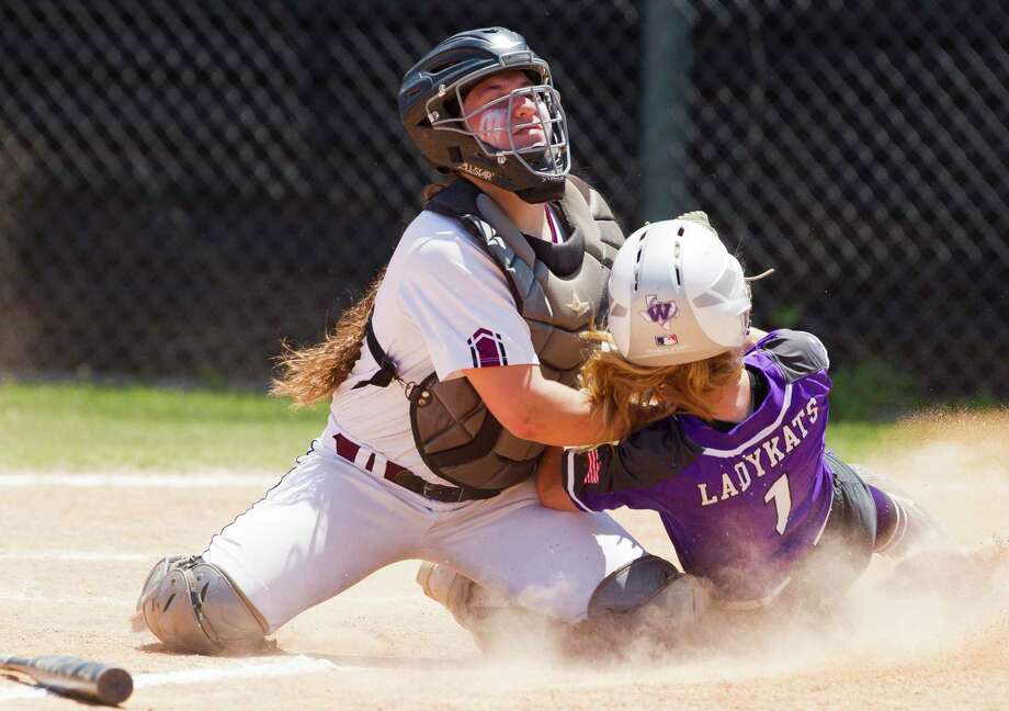 Magnolia catcher Alex DuBose (12) tags out Tyler Heffernan #1 of Willis at home plate during the fourth inning in Game 3 of a Region III-5A bi-district softball playoff match, Saturday, April 27, 2019, in Conroe. Photo: Jason Fochtman, Houston Chronicle / Staff Photographer / © 2019 Houston Chronicle