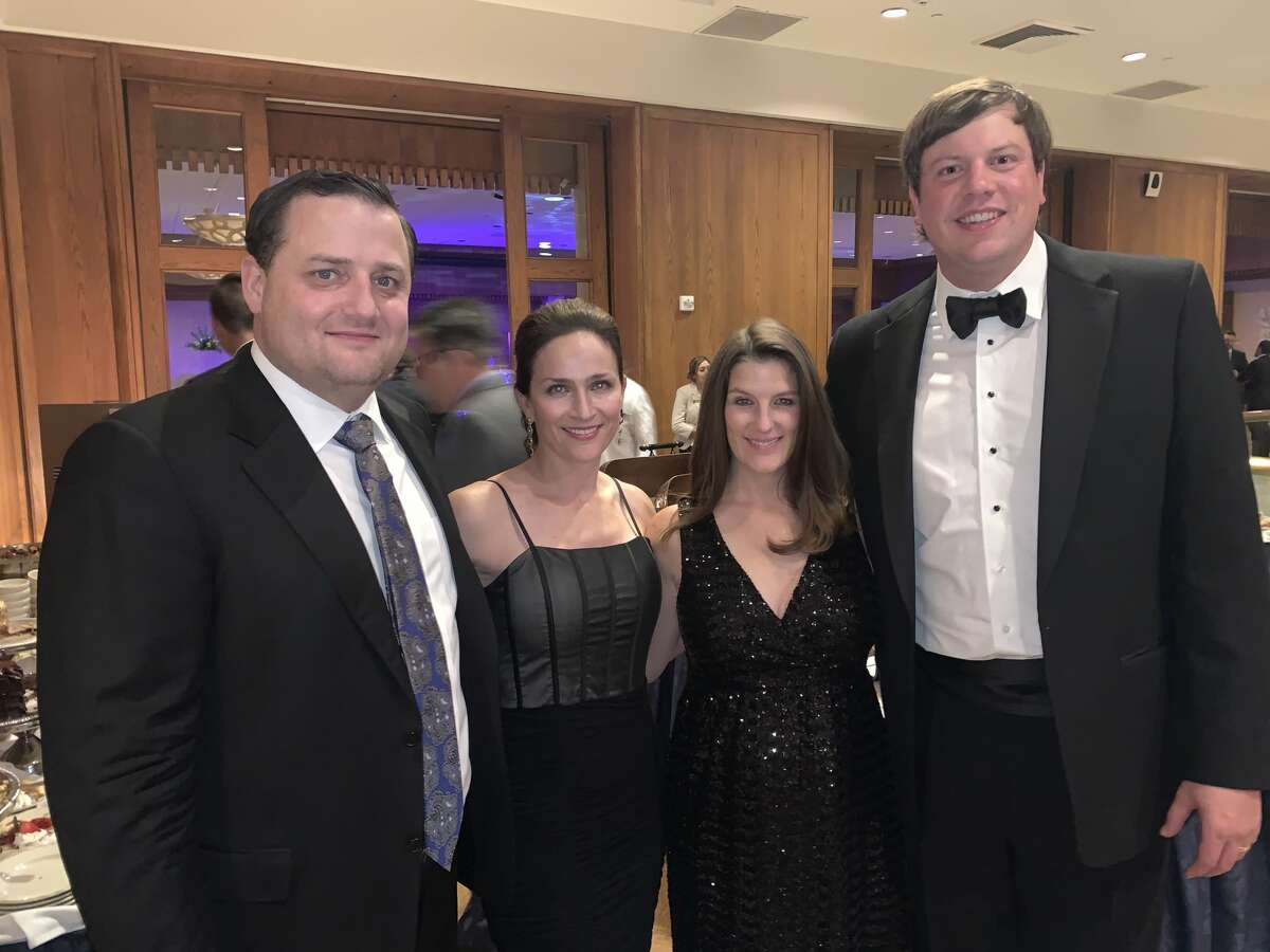 Coterie Club: T.J. and Ashlyn Midkiff, from left, and Natalie and Scott Stephens