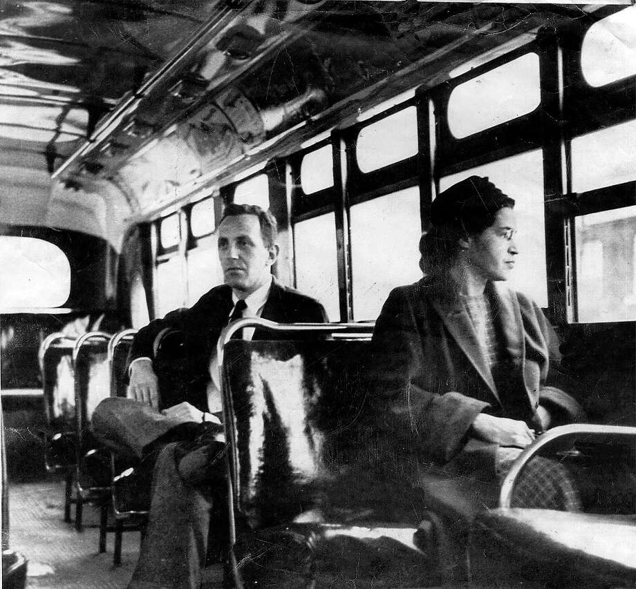 This undated file photo shows Rosa Parks riding on the Montgomery Area Transit System bus. Parks, whose refusal to give up her bus seat to a white man sparked the modern civil rights movement, died Monday Oct. 24, 2005. She was 92. Photo: AP / MONTGOMERY ADVERTISER
