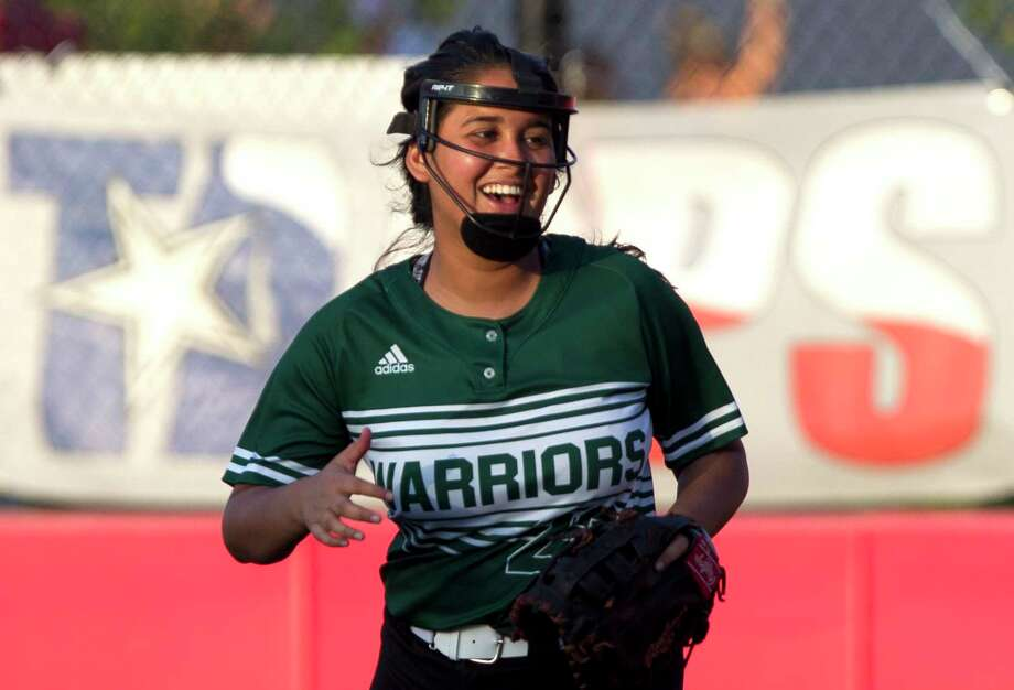 The Woodlands Christian Academy first baseman Mariska Cohelo (23) laughs after catching a pop-up by Alexia Garcia #23 of First Baptist Christian Academy to end the top of the third inning during a TAPPS Division III state semifinal game at The Ballparks in Crosby, Wednesday, May 15, 2019, in Crosby. Photo: Jason Fochtman, Houston Chronicle / Staff Photographer / © 2019 Houston Chronicle