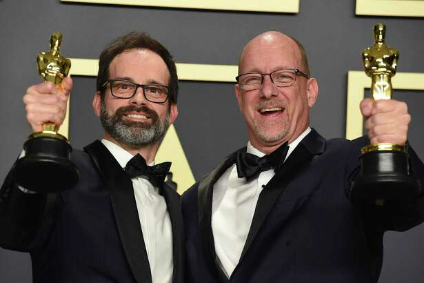"Andrew Buckland, left, and Michael McCusker, winners of the award for best film editing for ""Ford v Ferrari"", pose in the press room at the Oscars Sunday night, February 9, 2020, at the Dolby Theatre in Los Angeles. (Photo by Jordan Strauss/Invision/AP)"
