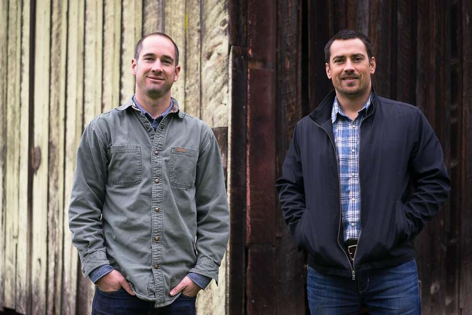 Mikey Giugni, left, and Michael Brughelli pose for a photo at Bear Valley Ranch in Aptos, Calif on Sunday, Dec. 20, 2015. Giugni and Brughelli are winemakers who are now making hard cider. Photo: James Tensuan / Special To The Chronicle 2015