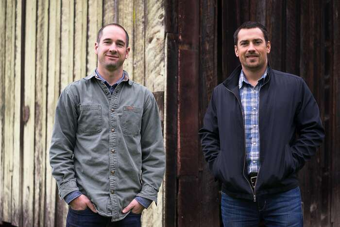 Mikey Giugni, left, and Michael Brughelli pose for a photo at Bear Valley Ranch in Aptos, Calif on Sunday, Dec. 20, 2015. Giugni and Brughelli are winemakers who are now making hard cider.