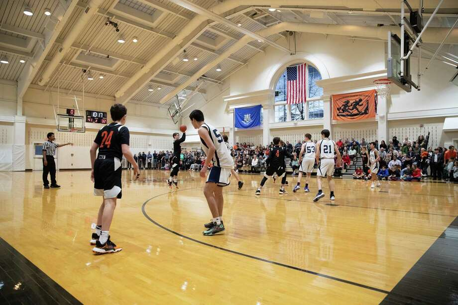 The Greenwich Country Day School community raised $1,000 for kids with cancer who love to dance during a Charity Hoops Night basketball game on Friday. The Center for Public Good, the school's new foundation that runs service projects and gives out grants, oversaw the event. Photo: Contributed