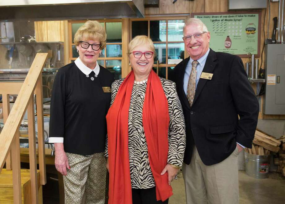 Melissa H. Mulrooney, SM&NC Executive Director & CEO, left, and Harry Day, President of the SM&NC Board of Directors, with Lidia Bastianich in the organization's Sugar House + Cidery. Photo: SM&NC / Contibuted Photo / Cara Gilbride   2019