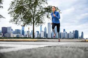 Woman working out in Chicago outdoor road runner in USA.