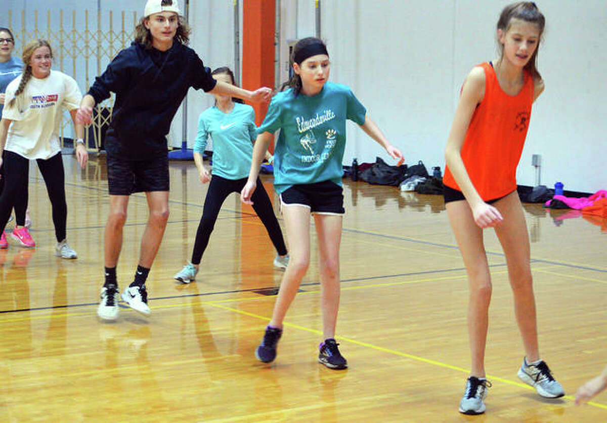Athletes perform drills during the Edwardsville tennis program's winter workouts last Thursday at EHS.
