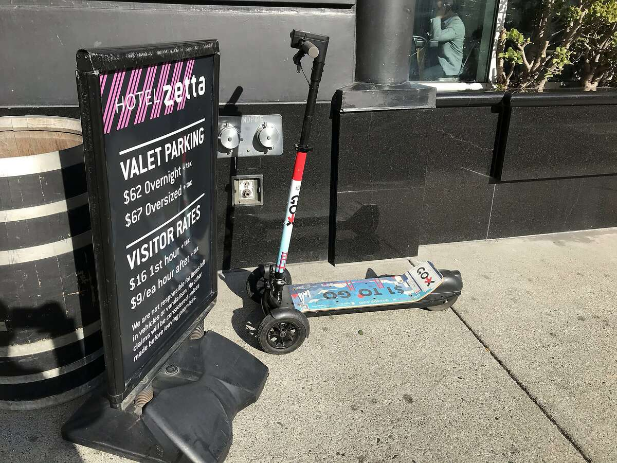 A three-wheel Go-X electric scooter is parked on the sidewalk in front of Hotel Zetta in San Francisco, Calif. on Tuesday, January 14, 2020. The company was hit with a cease and desist order on January 7, 2020 by city attorney Dennis Herrera, who alleged the company used fake permits with a pirated Chamber of Commerce logo. The company has racked up some $233,000-plus in fines for operating illegally in the city of San Francisco and was given until January 18 to permanently shut down operations.