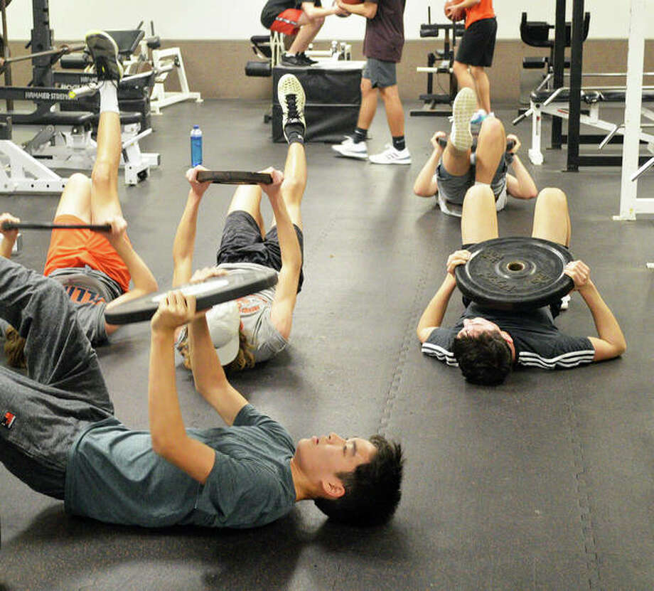 Weightlifting is among the activities for the Edwardsville tennis program's winter workouts, which are held three days a week at EHS from late November until the end of February. Photo: Scott Marion/The Intelligencer