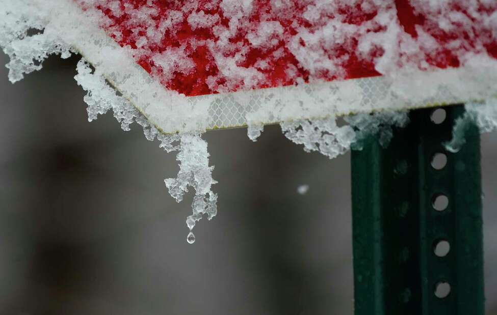A drop of water falls from some ice on a stop sign on Monday, Feb. 10, 2020, in Malta, N.Y. (Paul Buckowski/Times Union)