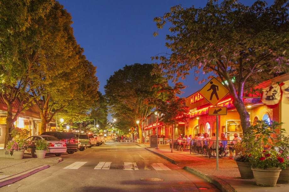 United States, Washington, Kirkland, street with shops and restaurants, lit at dusk Photo: Merrill Images/Getty Images