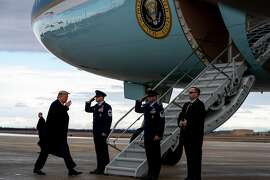 President Donald Trump boards Air Force One en route to the North Carolina Opportunity Now Summit, at Joint Base Andrews in Maryland Feb. 7, 2020. A federal appeals court panel threw out on Friday a lawsuit by 215 Democratic members of Congress accusing Trump of illegally accepting benefits from foreign governments, saying that individual lawmakers cannot sue the president on behalf of the entire Congress. (Anna Moneymaker/The New York Times)