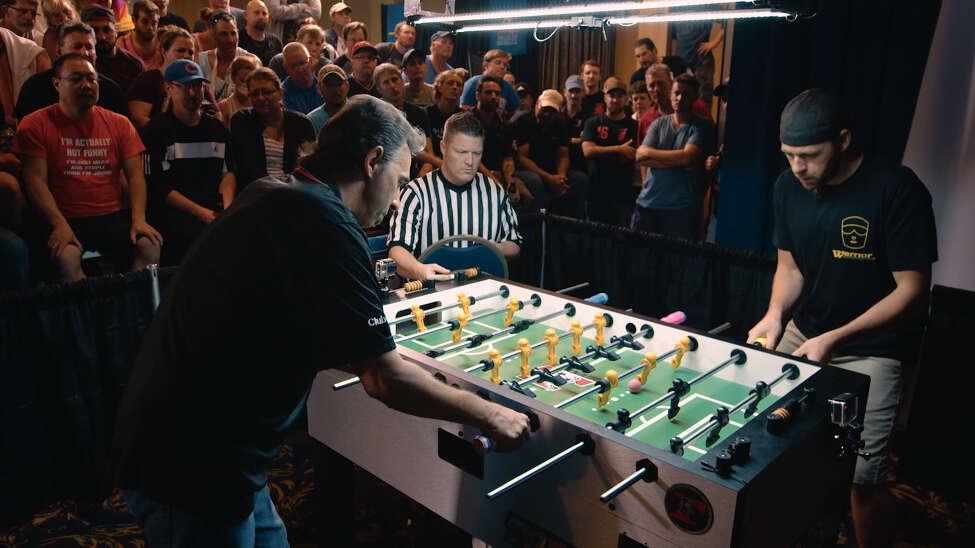 Tony Spredeman, left, and Todd Loffredo face off in a professional foosball tournament.
