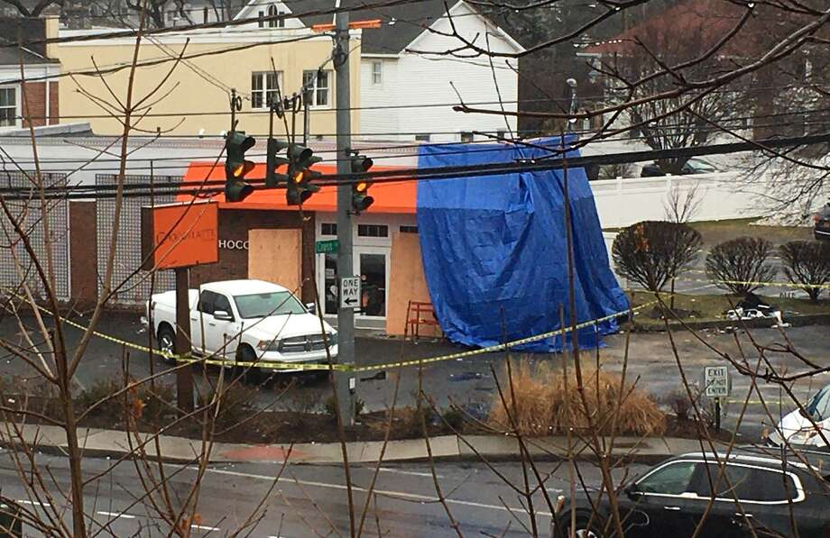 The Chocoylatte Gourmet bakery and cafe on the Post Road was severely damaged after it was struck by a car last week. The business remains closed. Photo: / Robert Marchant / Hearst Connecticut Media