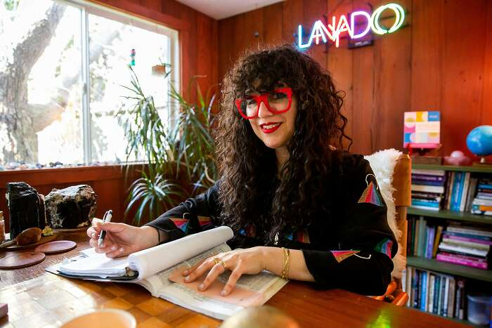 Jessica Lanyadoo, local Bay Area Astrologist and author of Astrology For Real Relationships, sits for a portrait at her studio in Oakland, Calif. on Wednesday, February 5, 2020. Lanyadoo has been a practicing professional astrologist in the Bay Area since 1995.