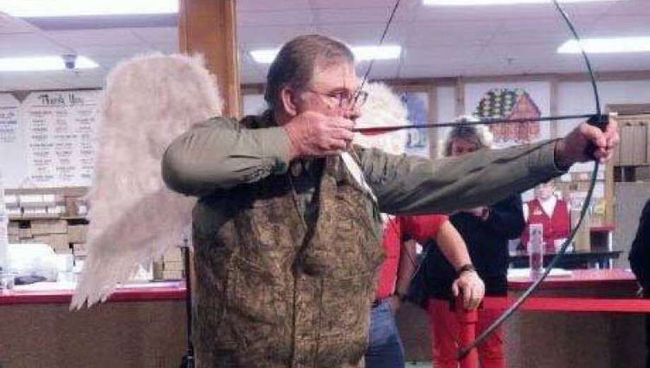 Tom Lounsbury, equipped with Cupid Wings, taking aim during a Bronner's Hotshot archery contest for charity. (Tom Lounsbury/Courtesy Photo)