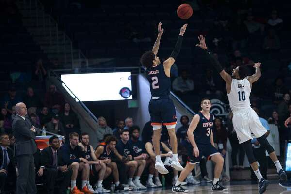 In overtime, UTSA's Jhivvan Jackson (2) makes a three-point basket over the defense of Old Dominion's Xavier Green during overtime of an NCAA college basketball game in Norfolk, Va., Thursday, Feb. 6, 2020. (L. Todd Spencer/The Virginian-Pilot via AP)