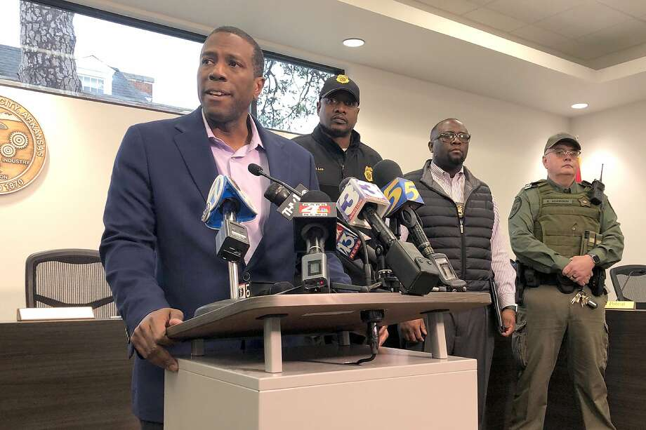 Forrest City, Ark., Mayor Cedric Williams, left, holds a news conference after two police officers were wounded and a gunman was killed in an exchange of gunfire at a Walmart store in eastern Arkansas Monday morning Feb. 10, 2020. Williams said that the officers were hospitalized soon after the shooting at the store about 45 miles west of Memphis. (AP Photo/Adrian Sainz) Photo: Adrian Sainz, Associated Press