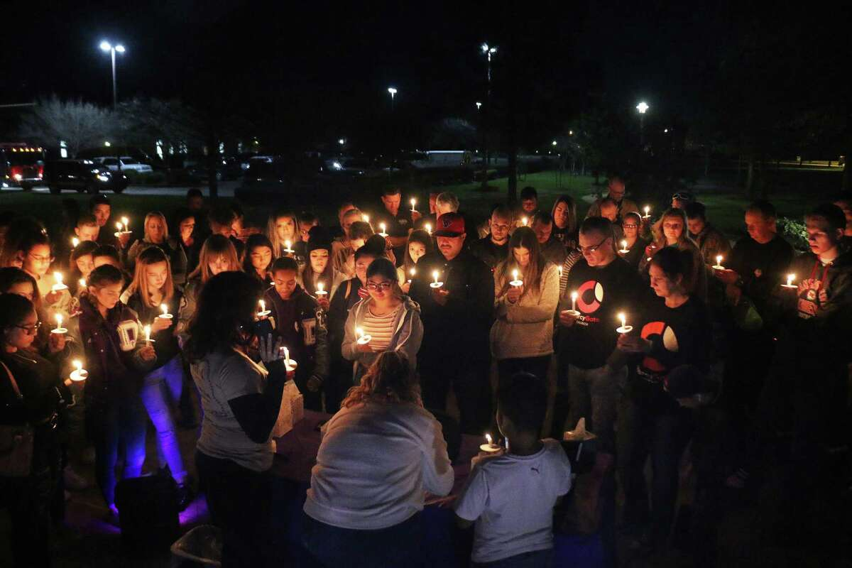 Several dozen family and friends gathered around the flagpole for a prayer vigil at the Dayton Community Center on Friday night in honor of their friend Maddii Quiroz.