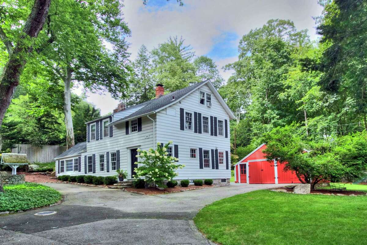 This property of almost a half an acre includes the Nathaniel S. Kirk house, built in 1868, and a red detached two-car garage that resembles a mini barn.