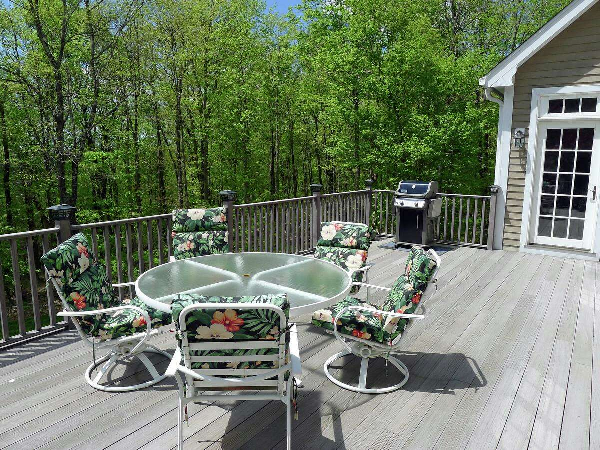 The large raised deck looks over the attractive, private property.