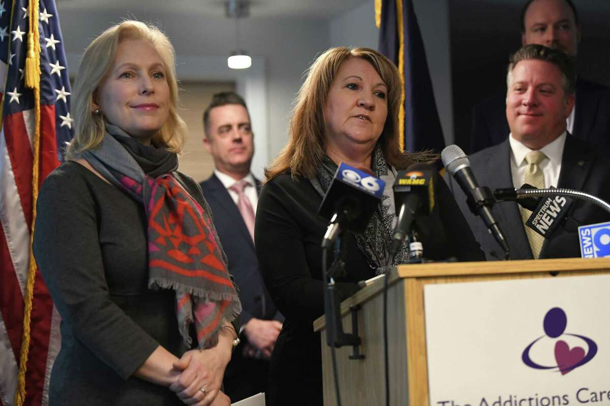 Kelly Fahrenkopf, Clinical Director for The Addictions Care Center of Albany, Inc., center, speaks as U.S. Senator Kirsten Gillibrand, left, visits the facility to announce her bipartisan legislation that would provide families with the tools they need to support their loved ones living with addiction on Monday, Feb. 10, 2020 in Albany, N.Y. (Lori Van Buren/Times Union)