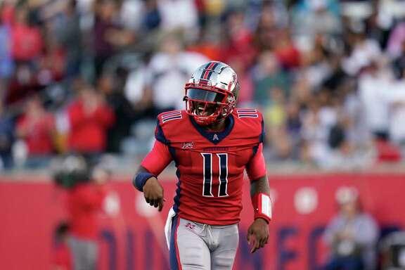 Houston Roughnecks quarterback P.J. Walker (11) celebrates after a touchdown during an XFL football game, Saturday, Feb. 8, 2020, in Houston. (AP Photo/Matt Patterson)