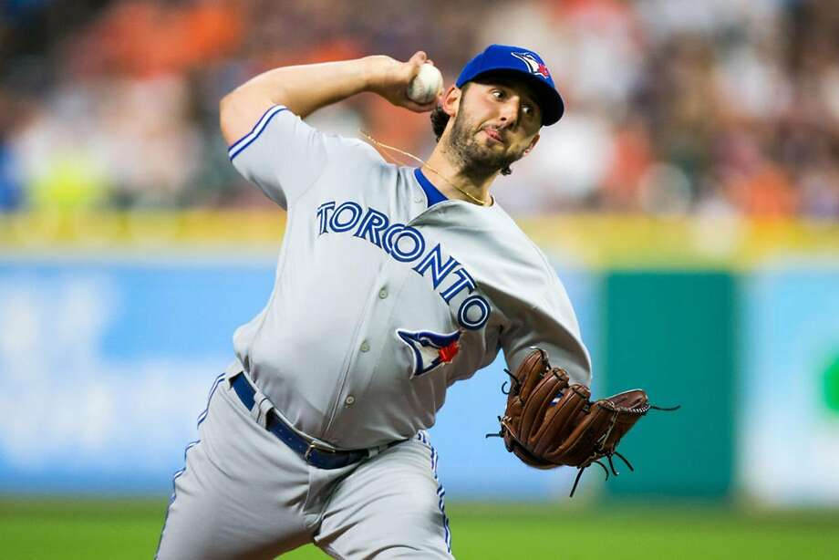 Toronto Blue Jays starting pitcher Mike Bolsinger (49) delivers the pitch in the fourth inning of a MLB game between the Houston Astros and the Toronto Blue Jays at Minute Maid Park, Friday, August 4, 2017. Houston Astros  defeated Toronto Blue Jays 16-7. (Juan DeLeon/Icon Sportswire via Getty Images/TNS) Photo: Juan DeLeon/Icon Sportswire, TNS