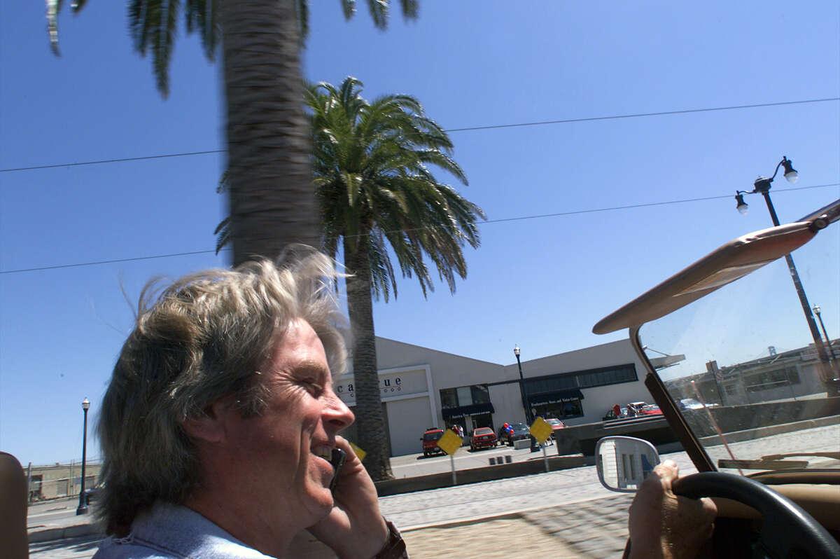 FILE - Bill Fink, Morgan guru in the Bay Area talks to a customer as he cruises around San Francisco.