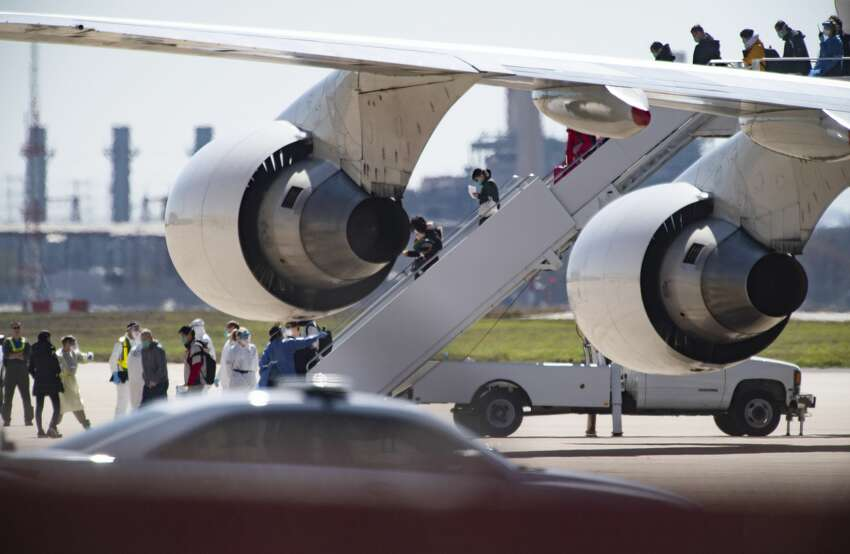 People at risk of carrying the coronavirus arrive at Joint Base San Antonio-Lackland aboard a chartered Boeing 747 on Friday, Feb. 7, 2020.