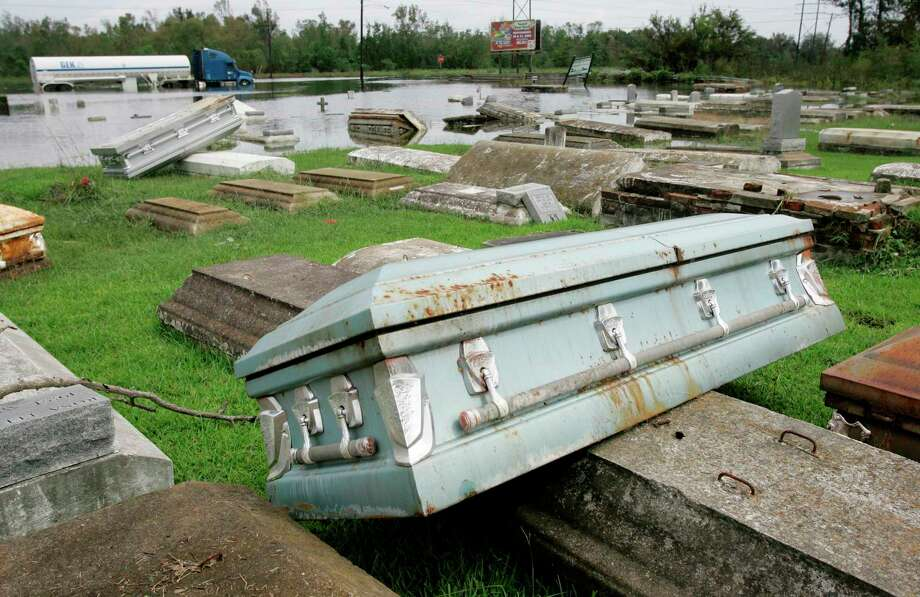 The Hollywood Community Cemetery is seen with several caskets scattered about after surfacing due to flood waters caused by Hurricane Ike, Sunday, Sept. 14, 2008, in Orange, Texas. Hurricane Ike's surge overcame the levee along the Sabine River that flows by Orange causing wide spread flooding to the city. (AP Photo/Tony Gutierrez) Photo: Tony Gutierrez, STF / AP / AP