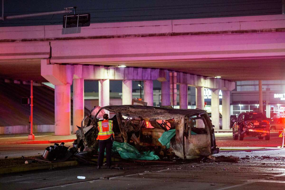 Authorities investigate a crash on Antoine Drive at the North Sam Houston Parkway underpass that killed three people on Wednesday, Feb. 5, 2020, in Houston.