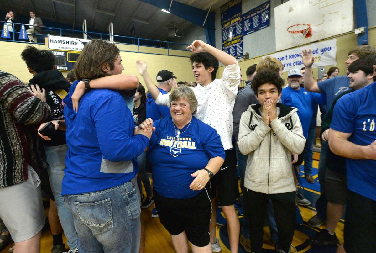 Hamshire-Fannett students, staff and coaches celebrate Monday during a surprise assembly at which they learned they won a national contest held by Hollman, Inc., and would receive brand new lockers. Photo taken Monday, February 10, 2020 Kim Brent/The Enterprise
