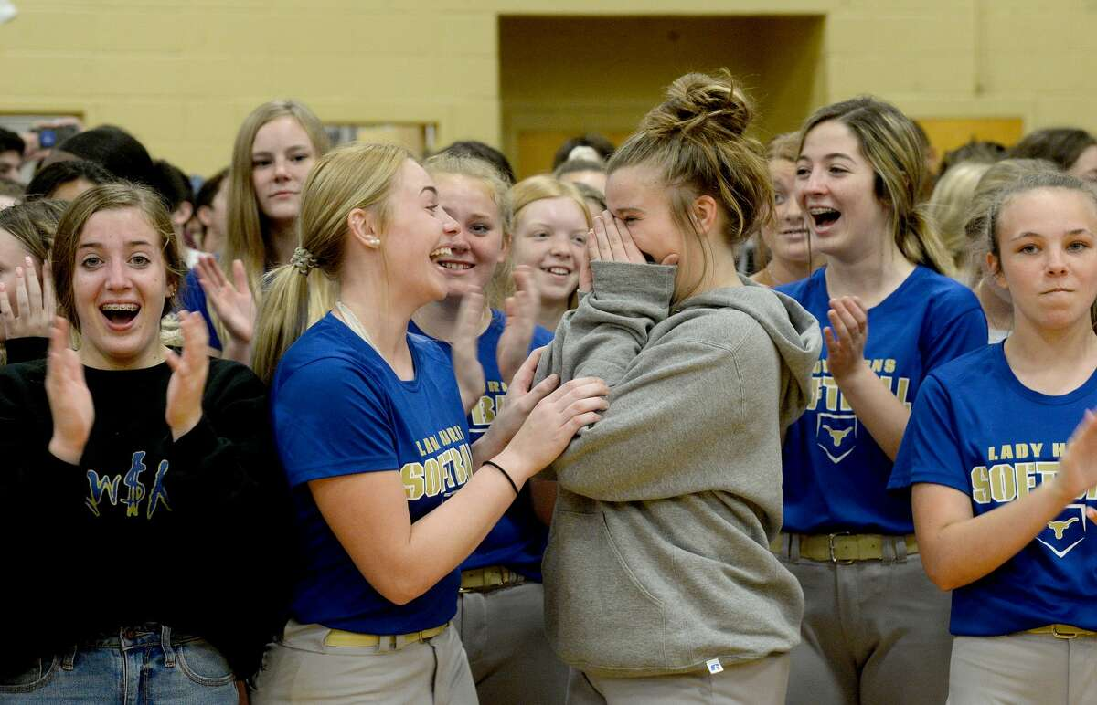 Hamshire-Fannett students, including Kiya Stanley (center left) and Brook Wendling, staff and coaches celebrate Monday during a surprise assembly at which they learned they won a national contest held by Hollman, Inc., and would receive brand new lockers. Photo taken Monday, February 10, 2020 Kim Brent/The Enterprise