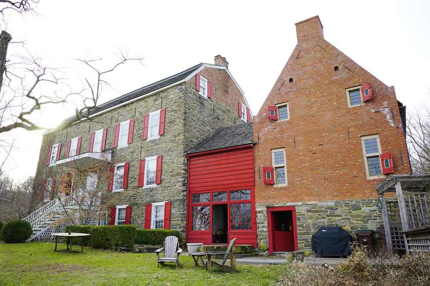 A view of the main house and the north house owned by Sylvia and Paul Lawler on Wednesday, Feb. 5, 2020, in Coeymans, N.Y. The work done to restore the main home, dating to 1690-1700, was recently recognized by the New York State Offices of Parks, Recreation and Historic Preservation. (Paul Buckowski/Times Union)